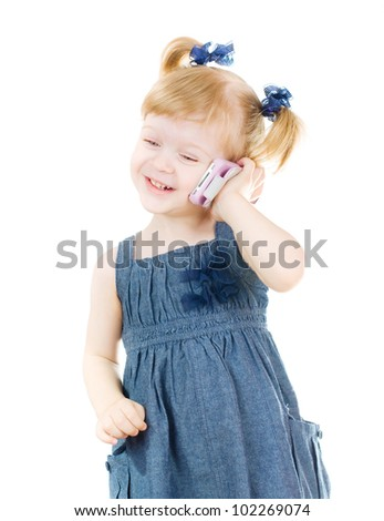little cute smiling girl speaking by a cell phone - stock photo