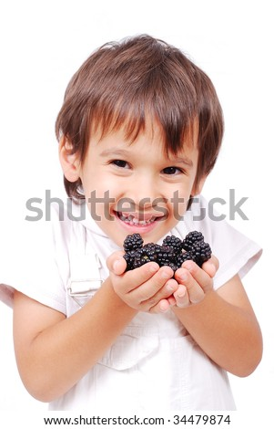 Little cute white kid with blackberry in hands