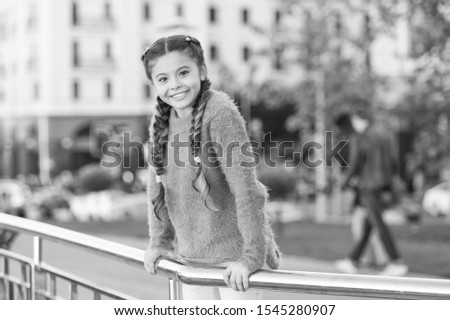 Little cutie. Adorable little kid with charming smile on summer day. Little child with brunette hair smiling in casual fashion style. Happy little girl with beauty look on urban background. #1545280907