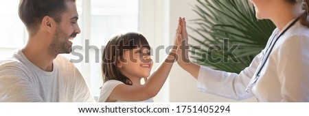 Little daughter gives high five to female doctor, pediatrician greets small kid girl patient, child healthcare medical check up, friendly relation concept. Horizontal banner for website header design Stockfoto ©