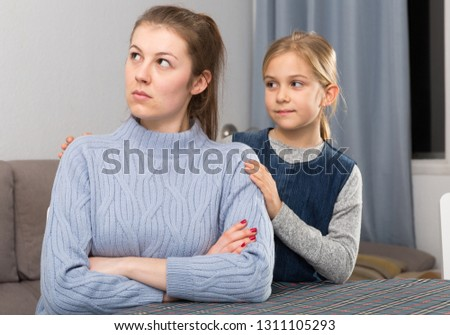 Little daughter soothe mom after an quarrel