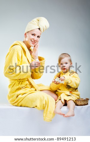 little daughter with her young mother  making up