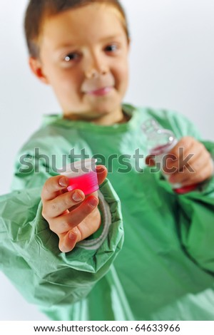 little  doctor  boy giving syrup
