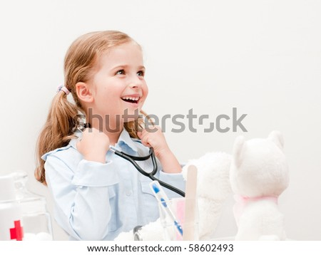 Little doctor examining teddy bear (no-name toys)