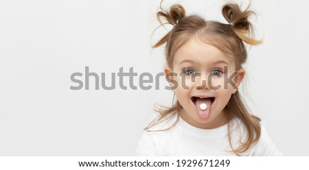 Little emotional adorible child with pill,candy,dragee on tongue. Taking medicine, vitamin supplements,nutrition,healt care, treatment concept. Complete multivitamin, mineral formula. Banner,mock up Foto stock ©