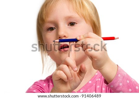Little emotional girl with blue and red  pencil isolated on white background