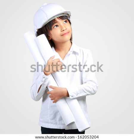 Little Engineer Little girl in the construction helmet with a poster Isolated on grey with clipping path