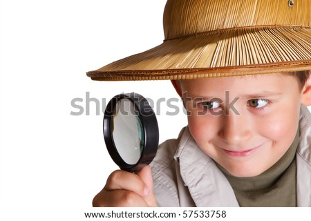 little explorer looking through the magnifying glass