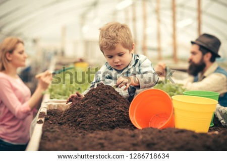 little farmer. little farmer work with soil. little farmer in greenhouse. little farmer child planting flowers #1286718634