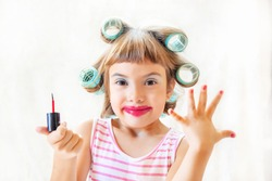 little fashion-girl. girl does her make up and manicure. selective focus. Children.