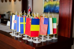 Little flags of different counties on the reception desk in a hotel