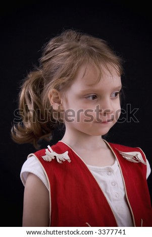 Little four year-old girl dressed in a red cowgirl outfit.