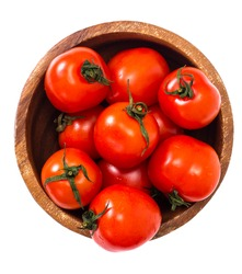 Little fresh tomatoes in a bowl. Studio Photo