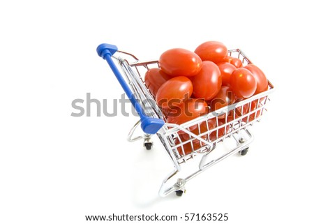 Little fresh tomatoes in a shopping trolley isolated over white