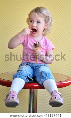 little funny blonde girl eating big ice cream