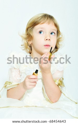 little funny blonde girl playing with lipstick