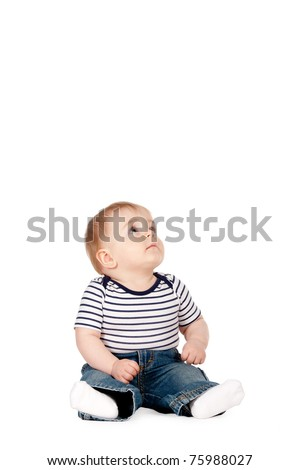 little funny boy looks up isolated on white