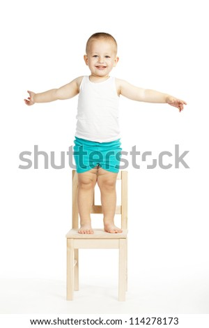little funny boy on a chair