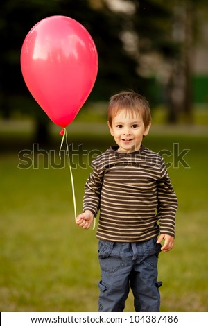 little funny boy with balloon