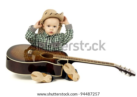 little funny boy with guitar