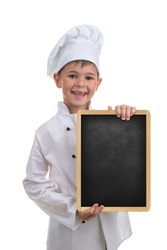 Little funny chef in white uniform holding a blackboard, on white background.
