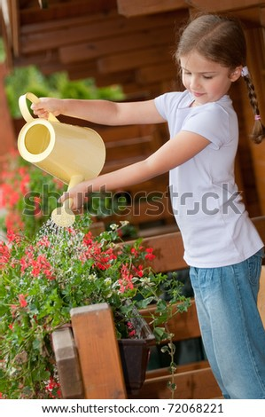 Little gardener watering flowers