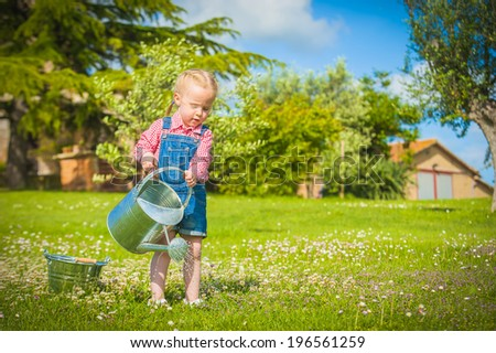 Little gardiner on the green grass in a summer day #196561259