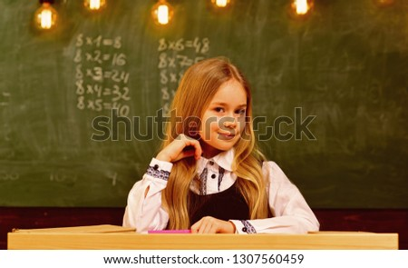 little genius at school. more idea of little genius. future little genius. little genius girl smiling at school. student on exam #1307560459