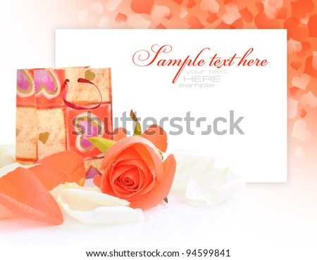 Little gift bag with rose on festive background with space for text