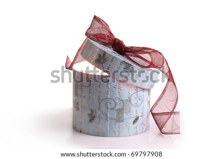 Little  gift on red background - stock photo