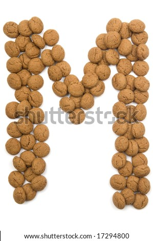 Little gingernuts (pepernoot)in the shape of a letter. These little gingernuts are used in Holland for the 'Sinterklaas' party, which is at Dec 5 every year. Sinterklaas is a sort of Santa Claus. Photo stock ©