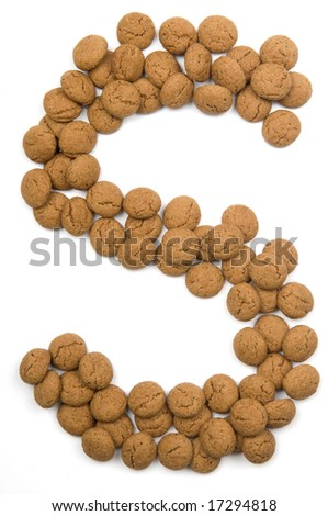 "Little gingernuts (pepernoot)in the shape of a letter. These little gingernuts are used in Holland for the ""Sinterklaas"" party, which is at Dec 5 every year. Sinterklaas is a sort of Santa Claus."