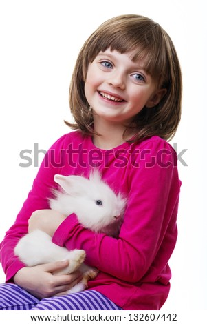 little girl and a little white rabbit