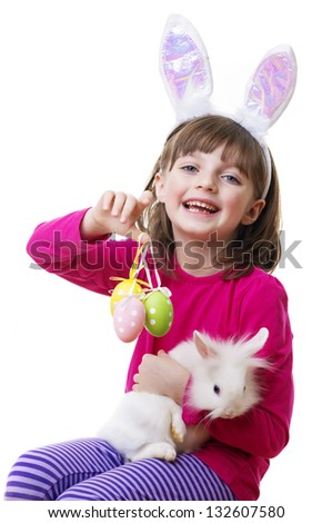little girl and a little white rabbit - easter - stock photo