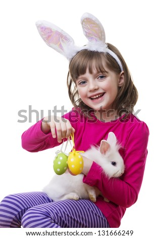 little girl and a little white rabbit - easter play