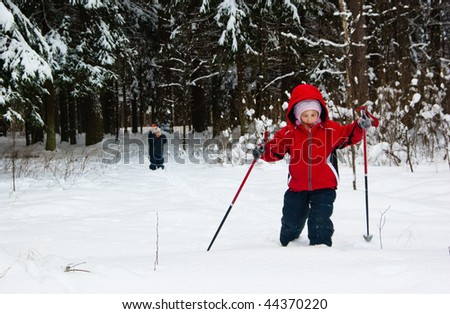 Little Girl and Boy Cross Country Skiing. Making a Ski Track.