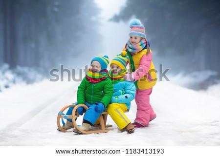 little girl and boy enjoying sleigh ride child sledding toddler kid riding a sledge - Christmas Vacation Sled