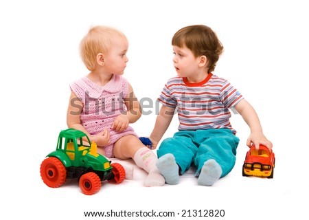Little girl and boy playing together. Isolated on white background
