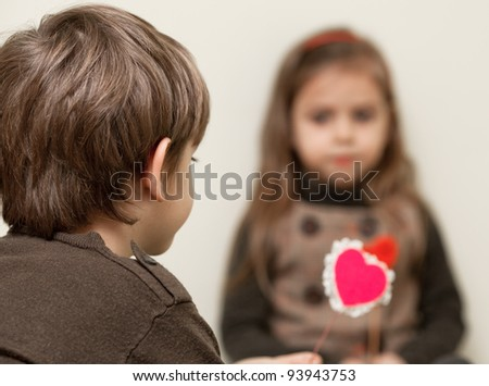 Little girl and boy with red heart