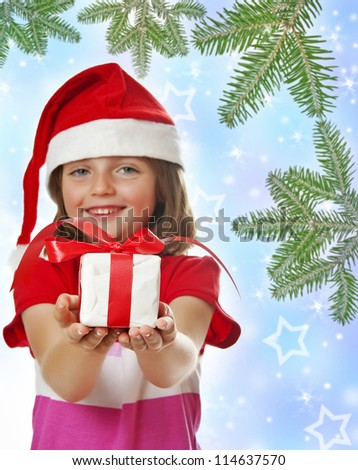 little girl and christmas gift - christmas background - stock photo