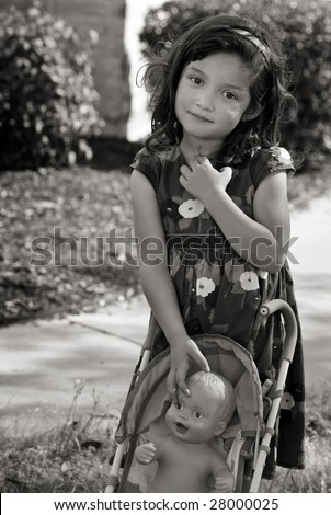 Little girl and her doll in B&W