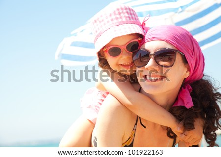little girl and her mother have  a good time at the seaside resort #101922163
