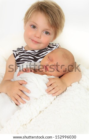 Little girl and her newborn baby sister.