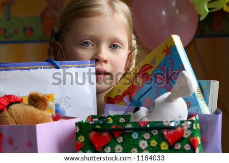 Little girl and her presents