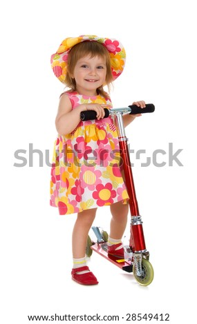 Little girl and her scooter. Studio isolated