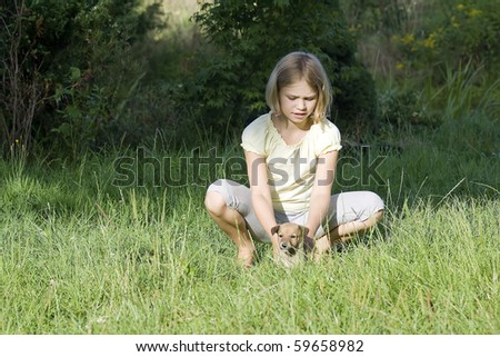 little girl and her very young dog