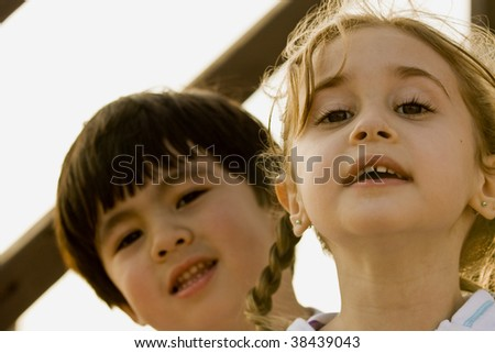 Little girl and Little Boy Looking at Camera