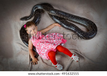 Little girl and snake in the studio #491632555