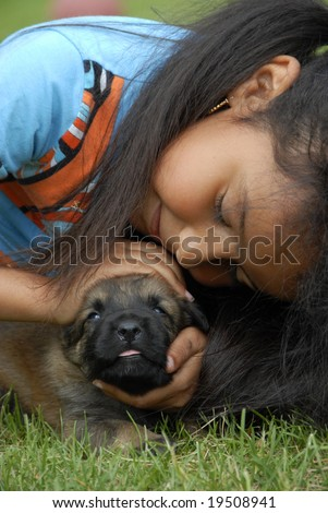 little girl and very young puppy belgian shepherd malinois