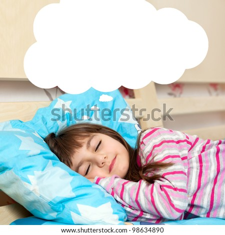little girl asleep in her bed and dreams